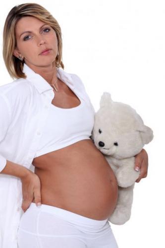 depositphotos_16617637-stock-photo-pregnant-woman-with-teddy-bear.jpg