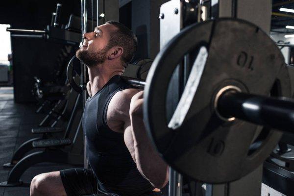 depositphotos_153984010-stock-photo-sportive-man-exercising-at-gym.jpg
