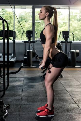 depositphotos_153985332-stock-photo-sportive-woman-exercising-at-gym.jpg
